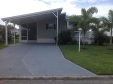 905 Frangi Pani Dr, Barefoot Bay, FL 32976