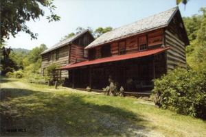 Two 1840 historic  log cabins on 136 acres!