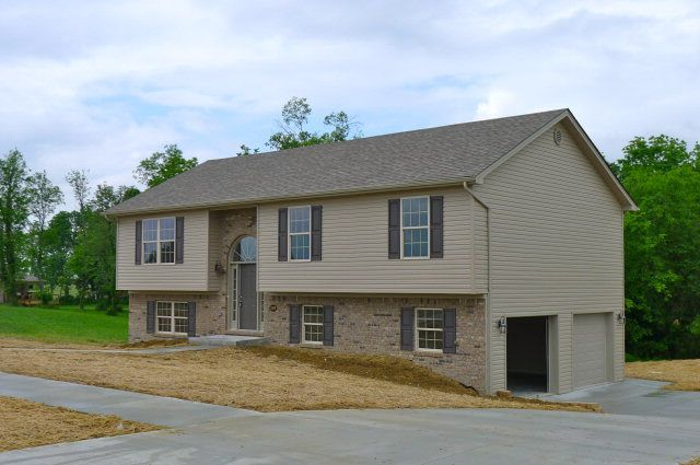 Under Construction Ranch Style All Brick Home Featuring Dining Room Living With Cathedral Ceiling And Kitchen Breakfast Area A Covered